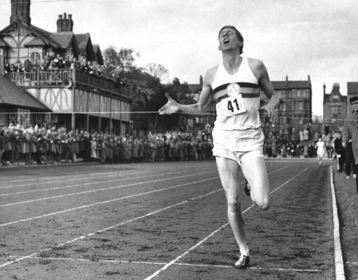 (AP Photo/File). FILE - In this May 6, 1954, file photo, British athlete Roger Bannister breaks the tape to become the first man ever to break the four minute barrier in the mile at Iffly Field in Oxford, England. Bannister, the first runner to break t...