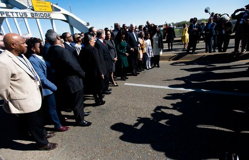 "(Albert Cesare/The Montgomery Advertiser via AP). Members of Congress and the Senate stand with others to pose for a picture during the  annual commemoration of ""Bloody Sunday,"" the day in 1965 when voting rights protesters were attacked by police as t..."