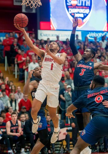 (AP Photo/Don Petersen). Radford guard Carlik Jones (1) shoots against Liberty guard Lovell Cabbil (3) during the first half of the Big South Conference Championship NCAA college basketball game , Sunday, March 4, 2018, in Radford Va.