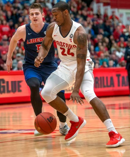 (AP Photo/Don Petersen). Radford forward Ed Polite Jr. (24) drives against Liberty guard Ryan Kemrite (5) during the first half of a Big South Conference championship NCAA college basketball game, Sunday, March 4, 2018, in Radford Va.