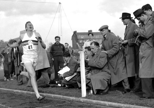 (AP Photo, File). FILE - In this May 6, 1954 file photo, Britain's Roger Bannister hits the tape to become the first person to break the four-minute mile in Oxford, England. A statement released Sunday March 4, 2018, on behalf of Bannister's family sai...