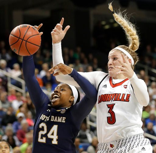 (AP Photo/Chuck Burton). Louisville's Sam Fuehring (3) and Notre Dame's Arike Ogunbowale (24) battle for a rebound during the first half of an NCAA college basketball game in the championship of the women's Atlantic Coast Conference tournament in Green...