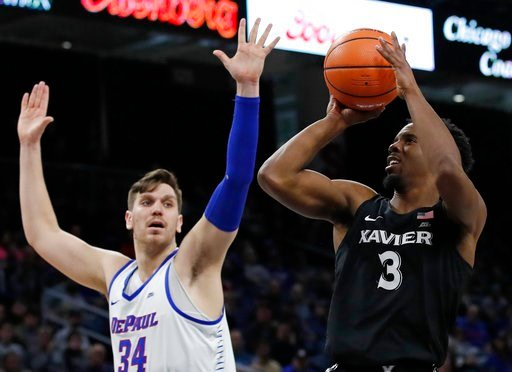 (AP Photo/Jim Young). Xavier guard Quentin Goodin (3) shoots against DePaul center Marin Maric (34) during the second half of an NCAA college basketball game Saturday, March 3, 2018, in Chicago, Ill.