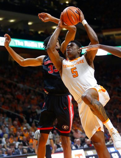 (AP Photo/Crystal LoGiudice). Tennessee forward Admiral Schofield (5) drives as Georgia forward Nicolas Claxton (33) defends during the second half of an NCAA college basketball game Saturday, March 3, 2018, in Knoxville, Tenn.