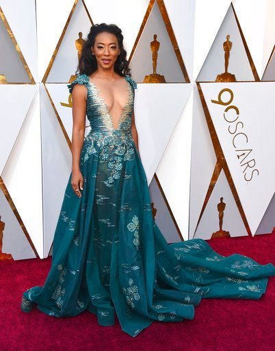 (Photo by Jordan Strauss/Invision/AP). Betty Gabriel arrives at the Oscars on Sunday, March 4, 2018, at the Dolby Theatre in Los Angeles.