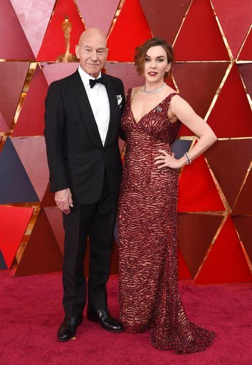 (Photo by Richard Shotwell/Invision/AP). Patrick Stewart, left, and Sunny Ozell arrive at the Oscars on Sunday, March 4, 2018, at the Dolby Theatre in Los Angeles.