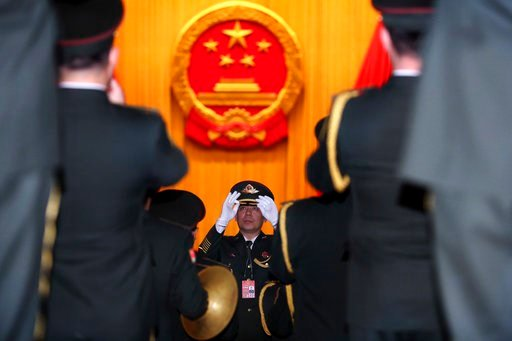 (AP Photo/Ng Han Guan). A Chinese military band conductor rehearses with the band before the opening session of the annual National People's Congress in Beijing's Great Hall of the People, Monday, March 5, 2018.