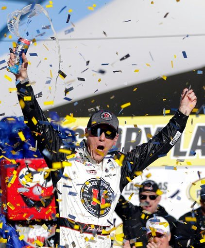 (AP Photo/Isaac Brekken). Kevin Harvick celebrates after winning a NASCAR Cup series auto race Sunday, March 4, 2018, in Las Vegas.