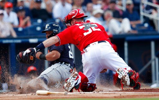 (AP Photo/John Bazemore). Detroit Tigers' Miguel Cabrera (24) is tagged out by Washington Nationals catcher Matt Wieters (32) as he tries to score on a Jim Adduci base hit in the first inning of a spring training baseball game, Sunday, March 4, 2018, i...