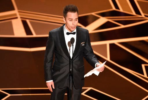 "(Photo by Chris Pizzello/Invision/AP). Sam Rockwell accepts the award for best performance by an actor in a supporting role for ""Three Billboards Outside Ebbing, Missouri"" at the Oscars on Sunday, March 4, 2018, at the Dolby Theatre in Los Angeles."