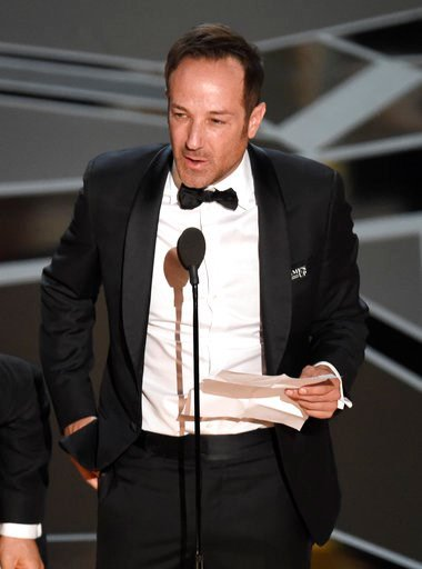 """(Photo by Chris Pizzello/Invision/AP). Bryan Fogel accepts the award for best documentary feature for """"Icarus"""" at the Oscars on Sunday, March 4, 2018, at the Dolby Theatre in Los Angeles."""