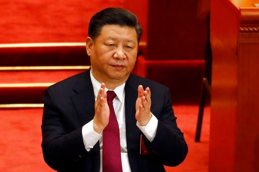 (AP Photo/Ng Han Guan). Chinese President Xi Jinping applauds during the opening session of the annual National People's Congress in Beijing's Great Hall of the People, Monday, March 5, 2018.