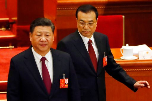 (AP Photo/Ng Han Guan). Chinese President Xi Jinping, left, and Chinese Premier Li Keqiang arrive for the opening session of the annual National People's Congress in Beijing's Great Hall of the People, Monday, March 5, 2018.