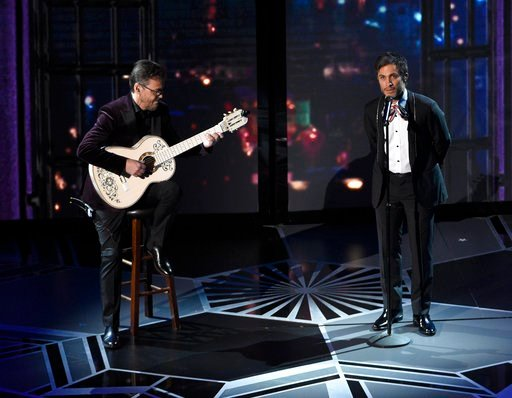"""(Photo by Chris Pizzello/Invision/AP). Gael Garcia Bernal performs """"Remember Me"""" from """"Coco"""" at the Oscars on Sunday, March 4, 2018, at the Dolby Theatre in Los Angeles."""