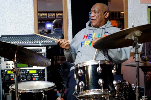 (AP Photo/Michael R. Sisak, File). In this Jan. 22, 2018, file photo, Bill Cosby, in his first public performance since his last tour ended amid protests in May 2015, plays the drums at the LaRose Jazz Club in Philadelphia.