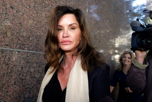 (AP Photo/Nick Ut, File). In this March 29, 2016, file photo, model Janice Dickinson leaves a hearing about her defamation lawsuit against Bill Cosby in Los Angeles Superior Court.