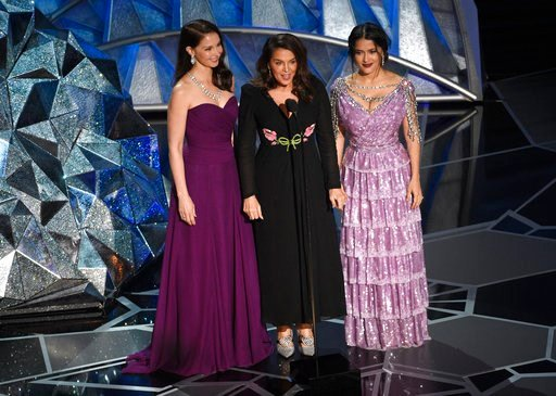 (Photo by Chris Pizzello/Invision/AP). Ashley Judd, from left, Annabella Sciorra and Salma Hayek speak at the Oscars on Sunday, March 4, 2018, at the Dolby Theatre in Los Angeles.