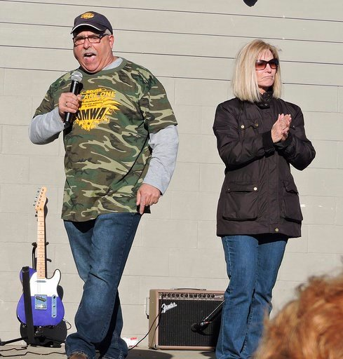 (Eddie Trizzino/Times-West Virginian via AP). Mike Caputo and Linda Longstreth, representatives for the House of Delegates for District 50, speak of the school employees' effect on Charleston at the teachers rally in Palatine Park in Fairmont, W.Va.
