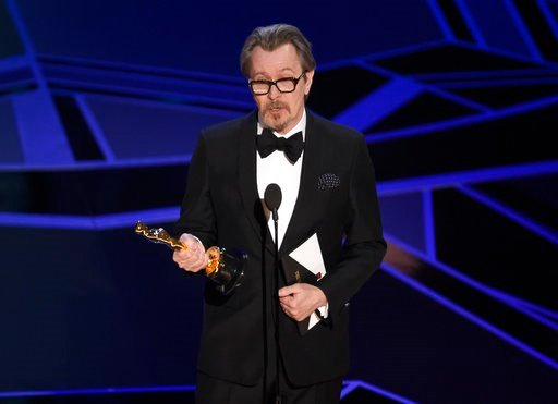 """(Photo by Chris Pizzello/Invision/AP). Gary Oldman accepts the award for best performance by an actor in a leading role for """"Darkest Hour"""" at the Oscars on Sunday, March 4, 2018, at the Dolby Theatre in Los Angeles."""
