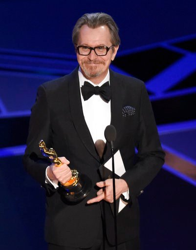 "(Photo by Chris Pizzello/Invision/AP). Gary Oldman accepts the award for best performance by an actor in a leading role for ""Darkest Hour"" at the Oscars on Sunday, March 4, 2018, at the Dolby Theatre in Los Angeles."