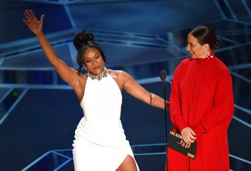 (Photo by Chris Pizzello/Invision/AP). Tiffany Haddish, left, and Maya Rudolph present the award for best documentary short subject at the Oscars on Sunday, March 4, 2018, at the Dolby Theatre in Los Angeles.