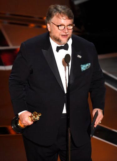"""(Photo by Chris Pizzello/Invision/AP). Guillermo del Toro accepts the award for best director for """"The Shape of Water"""" at the Oscars on Sunday, March 4, 2018, at the Dolby Theatre in Los Angeles."""