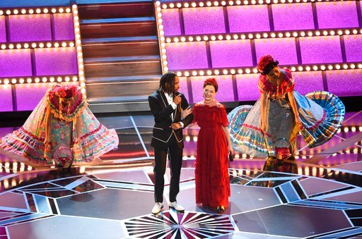 """(Photo by Chris Pizzello/Invision/AP). Miguel Lafourcade, left, and Natalia Lafourcade perform """"Remember Me"""" from """"Coco"""" at the Oscars on Sunday, March 4, 2018, at the Dolby Theatre in Los Angeles."""