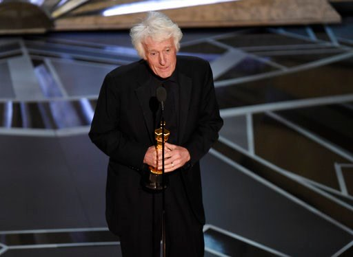 "(Photo by Chris Pizzello/Invision/AP). CORRECTS FILM TITLE TO BLADE RUNNER 2049 - Roger Deakins accepts the award for best cinematography for ""Blade Runner 2049"" at the Oscars on Sunday, March 4, 2018, at the Dolby Theatre in Los Angeles."
