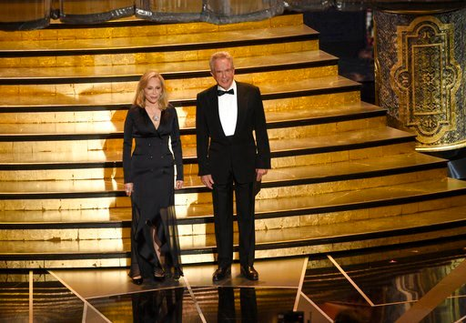 (Photo by Chris Pizzello/Invision/AP). Faye Dunaway, left, and Warren Beatty present the award for best picture at the Oscars on Sunday, March 4, 2018, at the Dolby Theatre in Los Angeles.