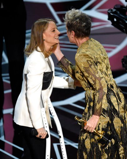 """(Photo by Chris Pizzello/Invision/AP). Jodie Foster, left, presents Frances McDormand with the award for best performance by an actress in a leading role for """"Three Billboards Outside Ebbing, Missouri"""" at the Oscars on Sunday, March 4, 2018, at the Dol..."""