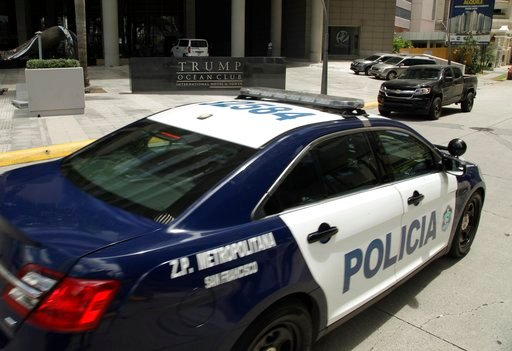 (AP Photo/Arnulfo Franco, File). FILE - In this Feb. 27, 2018 file photo, a Panamanian police car passes in front the Trump Ocean Club International Hotel and Tower in Panama City. The hotel remains open for business against a backdrop of service inter...