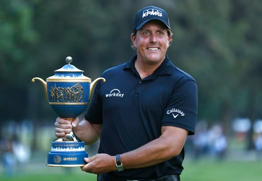 (AP Photo/Eduardo Verdugo). Phil Mickelson, of the U.S., poses with his Mexico Championship trophy at the Chapultepec Golf Club in Mexico City, Sunday, March 4, 2018.
