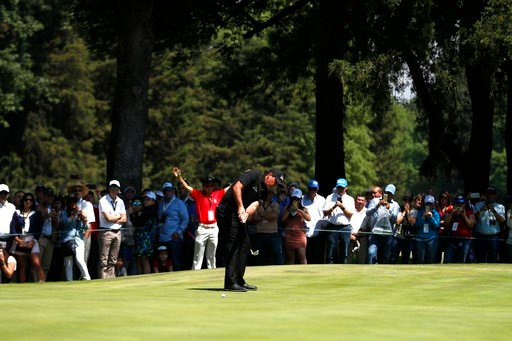(AP Photo/Eduardo Verdugo). Phil Mickelson, of the U.S., makes a shot on the green on the 3rd hole in the the final round of the Mexico Championship at Chapultepec Golf Club in Mexico City, Sunday, March 4, 2018.