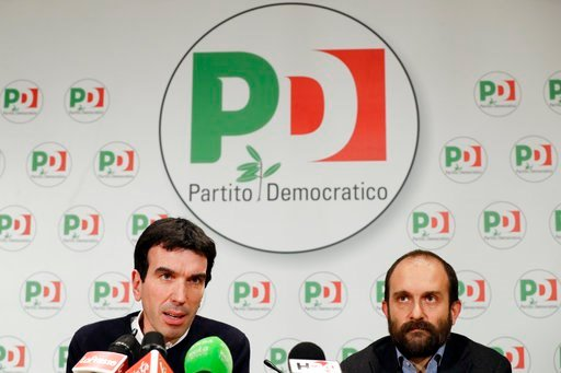 (AP Photo/Andrew Medichini). Democratic Party lawmaker Maurizio Martina, left, and President Matteo Orfini talk to journalists in the party's headquarters, in Rome, Sunday, March 4, 2018.