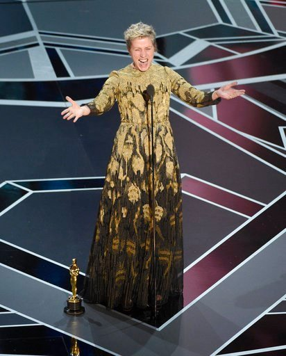 """(Photo by Chris Pizzello/Invision/AP). Frances McDormand accepts the award for best performance by an actress in a leading role for """"Three Billboards Outside Ebbing, Missouri"""" at the Oscars on Sunday, March 4, 2018, at the Dolby Theatre in Los Angeles."""