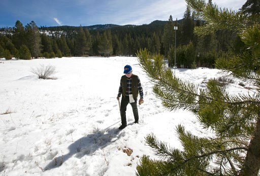 (AP Photo/Rich Pedroncelli, File). FILE - In this Feb. 1, 2018 file photo, Frank Gehrke, chief of the California Cooperative Snow Surveys Program for the Department of Water Resources, leaves a snow covered meadow after conducting the second snow surve...
