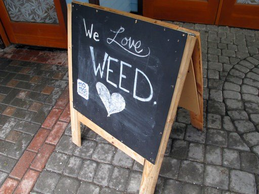 "(AP Photo/Becky Bohrer). In this Feb. 27, 2018, photo, a sign reading, ""We Love Weed"" stands outside a state-licensed marijuana shop in downtown Juneau, Alaska. Taking a cue from the fight over immigration, some states that have legalized marijuana are..."