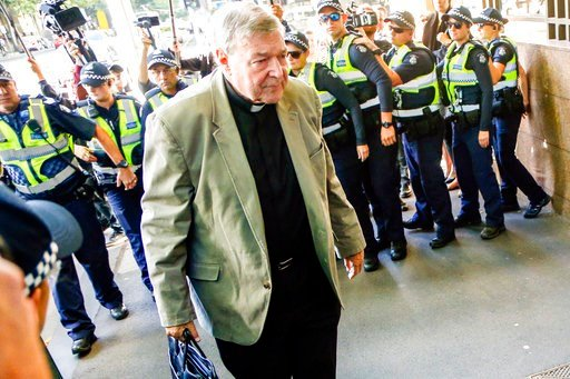(AP Photo/Asanka Brendon Ratnayake). Cardinal George Pell arrives at an Australian court, in Melbourne, Australia, Monday, March 5, 2018. Pell attended a hearing to determine whether prosecutors have sufficient evidence to try him on sexual abuse charg...
