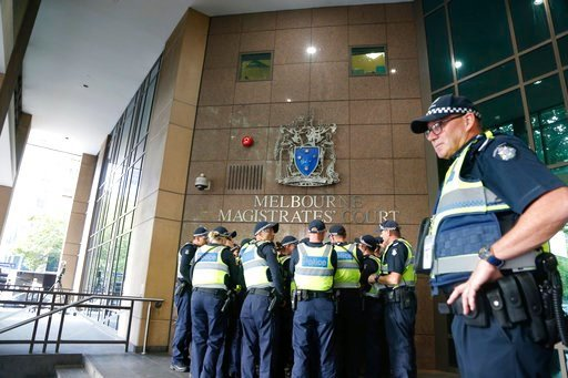 (AP Photo/Asanka Brendon Ratnayake). A group of Police officers standing at the front of the court awaiting the arrival of Cardinal George Pell, at an Australian court, in Melbourne, Australia, Monday, March 5, 2018. Pell attended a hearing to determin...