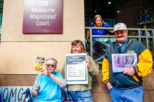(AP Photo/Asanka Brendon Ratnayake). Protestors hold signs against Australian Cardinal George Pell and child sex abuse in the country outside the Melbourne Magistrates Court during Pell's court hearing in Melbourne Monday, March 5, 2018. Cardinal Georg...