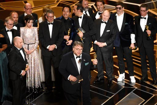 "(Photo by Chris Pizzello/Invision/AP). Guillermo del Toro and the cast and crew of ""The Shape of Water"" accept the award for best picture at the Oscars on Sunday, March 4, 2018, at the Dolby Theatre in Los Angeles."