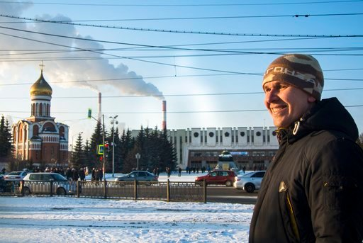 (AP Photo/Nataliya Vasilyeva). In this photo taken on Tuesday, Feb. 13, 2018, Uralvagonzavod worker Maxim Solozhnin stands outside his factory in Nizhny Tagil, Russia. Enthusiasm for President Vladimir Putin is waning at Uralvagonzavod, a train car and...