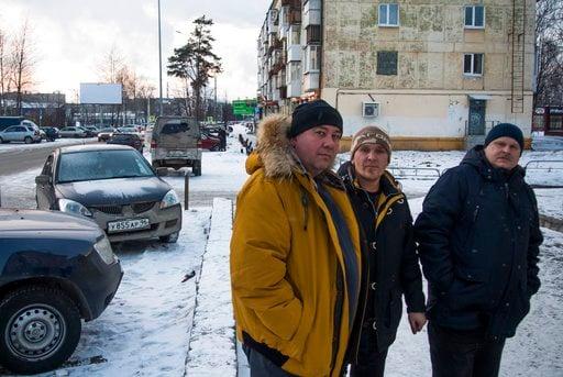(AP Photo/Nataliya Vasilyeva). In this photo taken on Tuesday, Feb. 13, 2018, Uralvagonzavod workers Valery Vdovin, left, Maxim Solozhnin, center, and Yevgeny Solozhnin stand on the street in Nizhny Tagil, Russia. Enthusiasm for President Vladimir Puti...