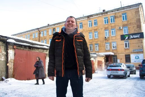 (AP Photo/Nataliya Vasilyeva). In this photo taken on Tuesday, Feb. 13, 2018, Uralvagonzavod worker Maxim Antonov stands in a courtyard in Nizhny Tagil, Russia. Enthusiasm for President Vladimir Putin is waning at Uralvagonzavod, a train car and tank f...