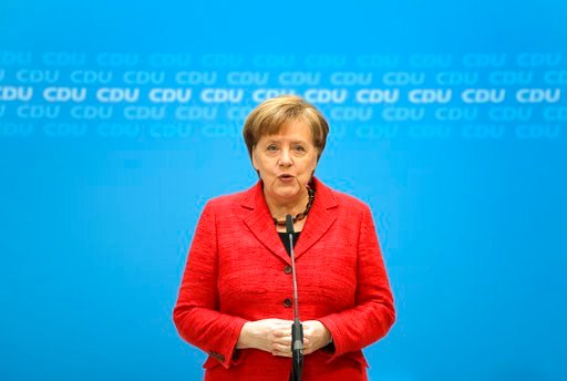 (AP Photo/Michael Sohn). German Chancellor and chairwomen of the German Christian Democratic Union (CDU), Angela Merkel, addresses the media during a statement at the party headquarters in Berlin, Germany, Monday, March 5, 2018.