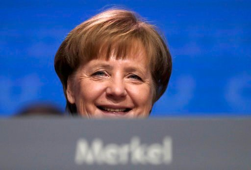 (AP Photo/Markus Schreiber, file). FILE - In this Feb. 26, 2018 file photo German Chancellor and party chairwoman Angela Merkel smiles at the party convention of the Christian Democratic Union CDU in Berlin. The members of the Social Democratic party v...