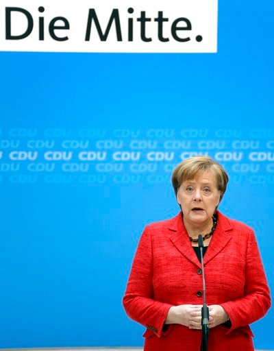 (AP Photo/Michael Sohn). German Chancellor and chairwomen of the German Christian Democratic Union (CDU), Angela Merkel, addresses the media during a statement at the party headquarters in Berlin, Germany, Monday, March 5, 2018. Logo slogan reads 'In t...