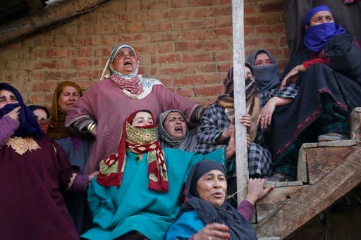 (AP Photo/Mukhtar Khan). Kashmiri village women react as they watch from a distance the funeral of civilian Suhail Ahmad at Pinjura village 52 kilometers (33 miles) south of Srinagar, Indian controlled Kashmir, Monday, March 5, 2018. More than a dozen ...