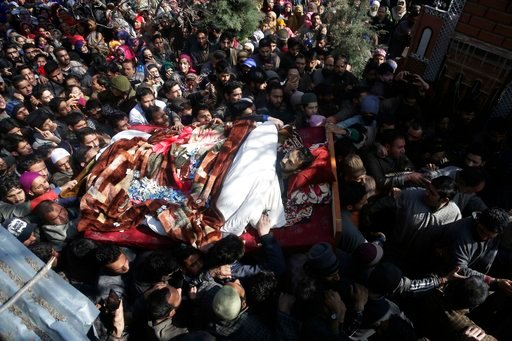 (AP Photo/Mukhtar Khan). Kashmiri villagers shout slogans as they carry the body of a civilian Suhail Ahmad during his funeral at Pinjura village 52 kilometers (33 miles) south of Srinagar, Indian controlled Kashmir, Monday, March 5, 2018. More than a ...