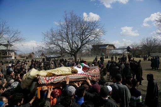 (AP Photo/Mukhtar Khan). Kashmiri villagers carry the body of a civilian Suhail Ahmad during his funeral at Pinjura village 52 kilometers (33 miles) south of Srinagar, Indian controlled Kashmir, Monday, March 5, 2018. More than a dozen protests erupted...